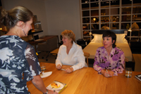 Chris Ann getting her book signed by Lynne Rosetta Kasper and Sally Swift